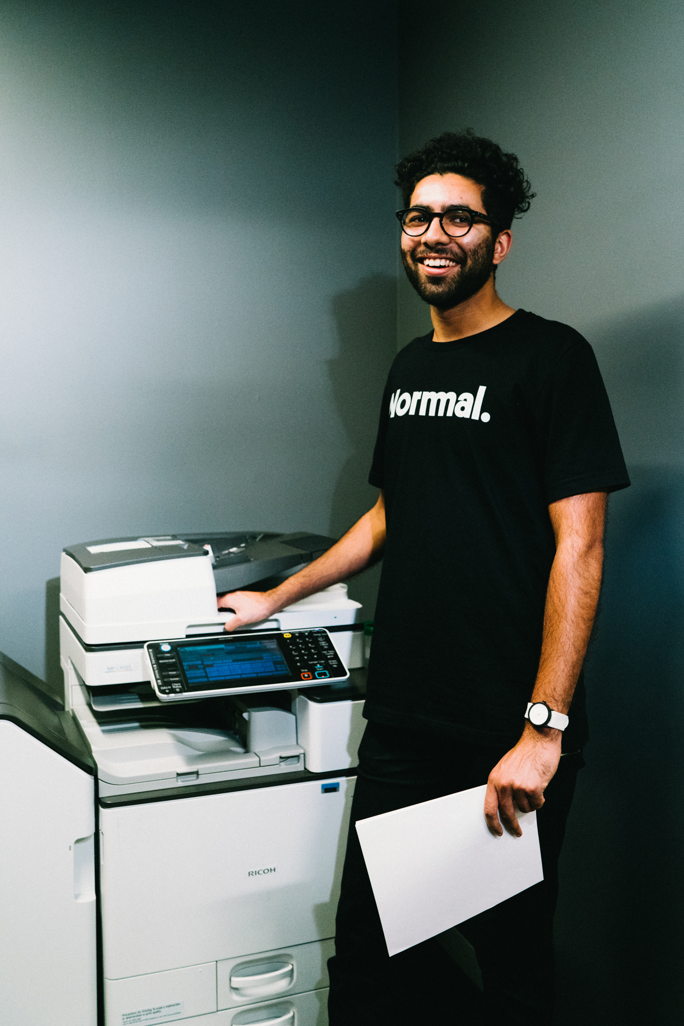 1 Normal standing by a copy machine